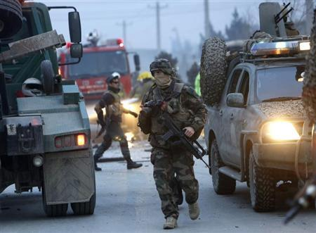 NATO soldiers arrive at the site of a suicide bomb attack in Kabul