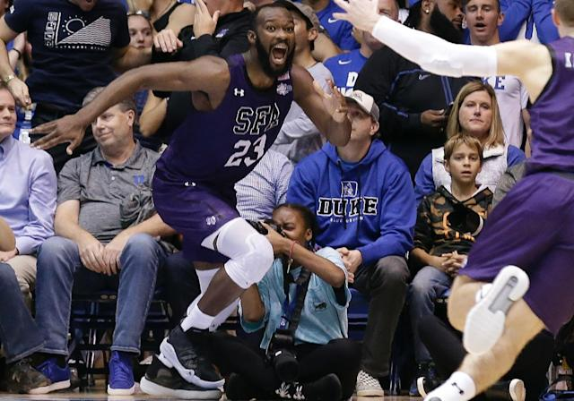 "<a class=""link rapid-noclick-resp"" href=""/ncaab/players/132475/"" data-ylk=""slk:Nathan Bain"">Nathan Bain</a> choked back tears as he talked about his family after Tuesday's emotional upset of Duke. (AP Photo/Gerry Broome)"