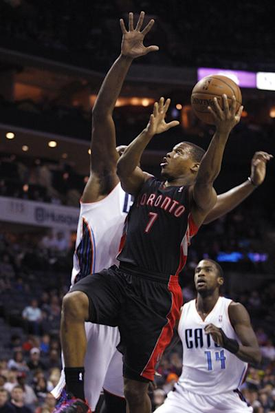 CORRECTS DATE TO JAN. 20 - Toronto Raptors guard Kyle Lowry (7) drives to the basketball against the Charlotte Bobcats in the first half of an NBA basketball game Monday, Jan. 20, 2014 in Charlotte, N.C. (AP Photo/Nell Redmond)