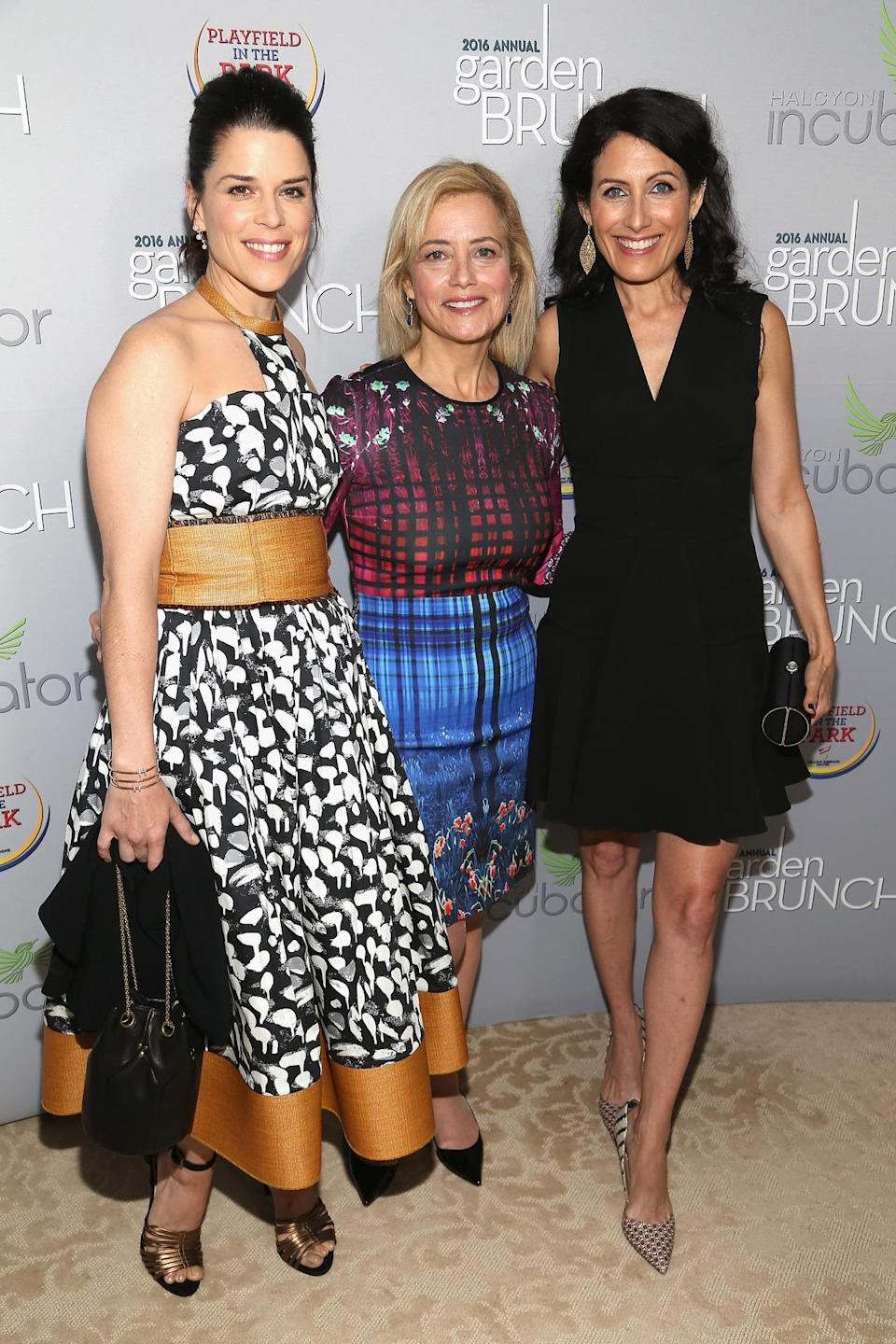 <p>Neve Campbell, Hilary Rosen and Lisa Edelstein attend the Garden Brunch prior to the 102nd White House Correspondents' Dinner, April 30. <i>(Photo: Paul Morigi/WireImage)</i></p>