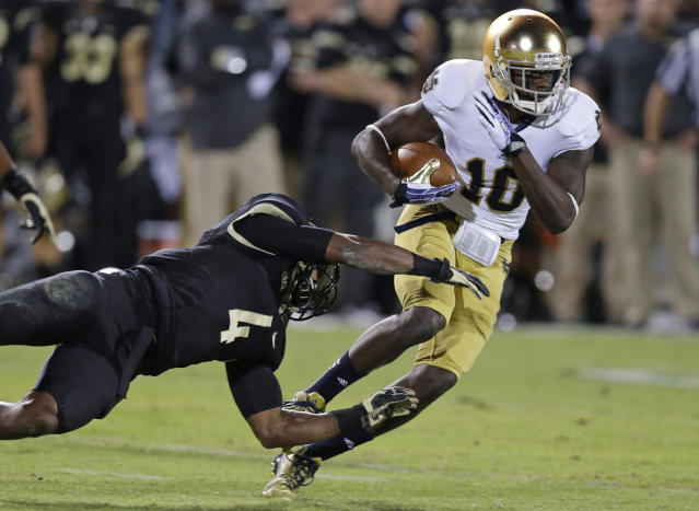 Notre Dame wide receiver DaVaris Daniels, right, is tackled by Purdue safety Taylor Richards after making a catch during the first half of an NCAA college football game in West Lafayette, Ind., Saturday, Sept. 14, 2013. (AP Photo/Michael Conroy)