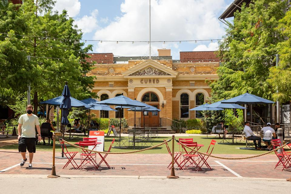 New technology at San Antonio's wildly popular Pearl Brewery allows diners at outside tables to combine choices from multiple food hall vendors into a single order delivered tableside.