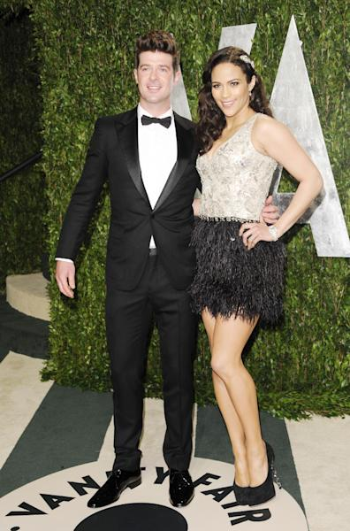 """FILE - In this Sunday, Feb. 26, 2012 file photo, singer Robin Thicke and wife actress Paula Patton arrive at the Vanity Fair Oscar party in West Hollywood, Calif. Robin Thicke wrote and produced the 2004 Usher song """"Can U Handle It,"""" which features vocals from his wife, actress Paula Patton. He says though she can sing, Patton doesn't have plans to release her own music. (AP Photo/Evan Agostini, File)"""