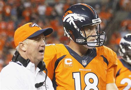 Denver Broncos quarterback Peyton Manning (R) listens to Broncos head coach John Fox late in the fourth quarter in their NFL football game against the Baltimore Ravens in Denver September 5, 2013. REUTERS/Rick Wilking
