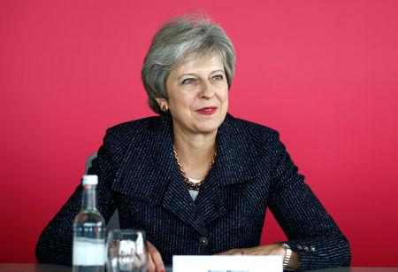 Britain's Prime Minister Theresa May attends a roundtable meeting with business leaders whose companies are inaugural signatories of the Race at Work Charter at the Southbank Centre in London, Britain, October 11, 2018. REUTERS/Henry Nicholls