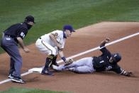 Milwaukee Brewers third baseman Brock Holt tags out Chicago White Sox's Nick Madrigal at third during the third inning of a baseball game Tuesday, Aug. 4, 2020, in Milwaukee. Madrigal tried to advance from first on a hit by Luis Robert. (AP Photo/Morry Gash)
