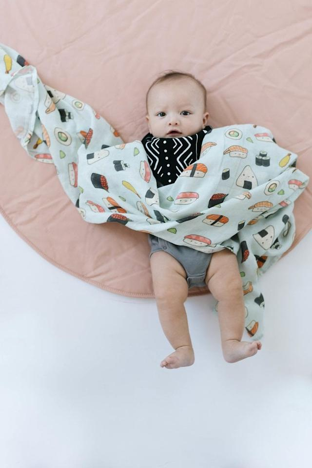"""<p>""""It's impossible to have too many muslin swaddles (OK, so at some point it <em>may</em> be possible), and this <a rel=""""nofollow"""" href=""""https://www.popsugar.com/buy/Loulou%20Lollipop%20Sushi%20Swaddle-417118?p_name=Loulou%20Lollipop%20Sushi%20Swaddle&retailer=louloulollipop.com&price=25&evar1=moms%3Aus&evar9=45858757&evar98=https%3A%2F%2Fwww.popsugar.com%2Ffamily%2Fphoto-gallery%2F45858757%2Fimage%2F45858795%2FLoulou-Lollipop-Sushi-Muslin-Swaddle&prop13=api&pdata=1"""" rel=""""nofollow"""">Loulou Lollipop Sushi Swaddle</a> ($25) is way too cute to pass up. Whether you love sushi and it was the thing you missed most during your pregnancy or you just love an adorable, trendy piece to photograph for the 'gram, this swaddle needs to be added to your cart."""" - Alessia Santoro, editor, Family</p>"""