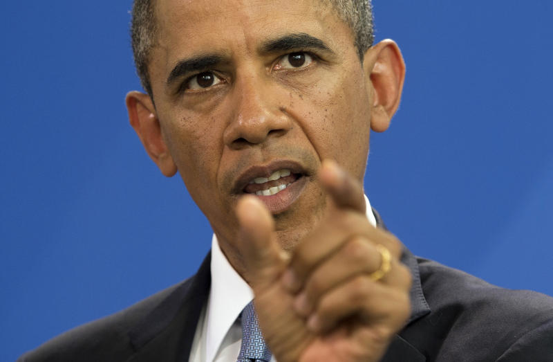 U.S. President Barack Obama gestures during a news conference with German Chancellor Angela Merkel at the German Chancellery on Wednesday, June 19, 2013, in Berlin. Obama will renew his call to reduce the world's nuclear stockpiles, including a proposed one-third reduction in U.S. and Russian arsenals, a senior administration official said. (AP Photo/Evan Vucci)