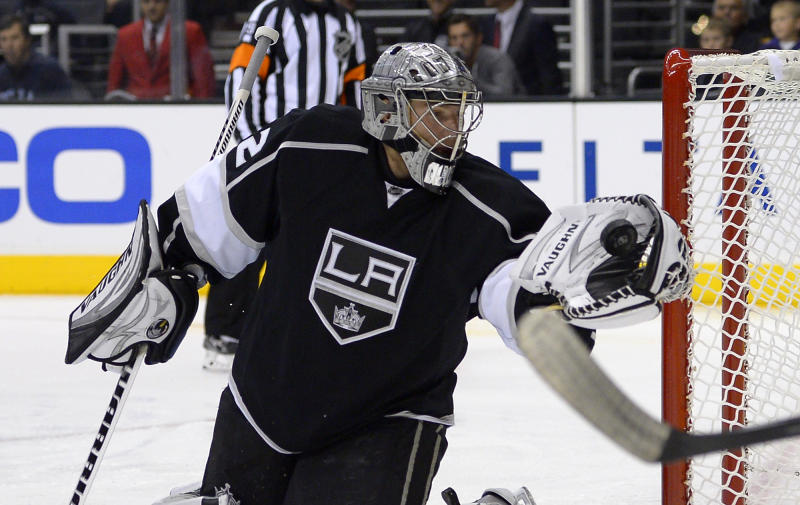 Los Angeles Kings goalie Jonathan Quick makes a glove save during the first period of an NHL preseason hockey game against the Anaheim Ducks, Tuesday, Sept. 24, 2013, in Los Angeles. (AP Photo/Mark J. Terrill)
