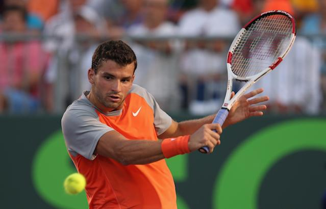 KEY BISCAYNE, FL - MARCH 23: Grigor Dimitrov of Bulgaria plays a backhand against Kei Nishikori of Japan during their third round match during day 7 at the Sony Open at Crandon Park Tennis Center on March 23, 2014 in Key Biscayne, Florida. (Photo by Clive Brunskill/Getty Images)