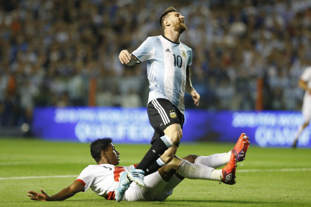"<a class=""link rapid-noclick-resp"" href=""/soccer/players/lionel-messi/"" data-ylk=""slk:Lionel Messi"">Lionel Messi</a> and Argentina were held to a draw by Peru. (Getty)"