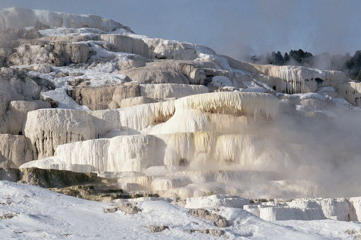 <p>This photo shows just how cold it gets in Yellowstone National Park during the winter: the Mammoth Hot Springs are so frozen over you can barely even tell what they are. The ice is super thick and won't thaw for a while, but it does make for a beautiful photo. </p>