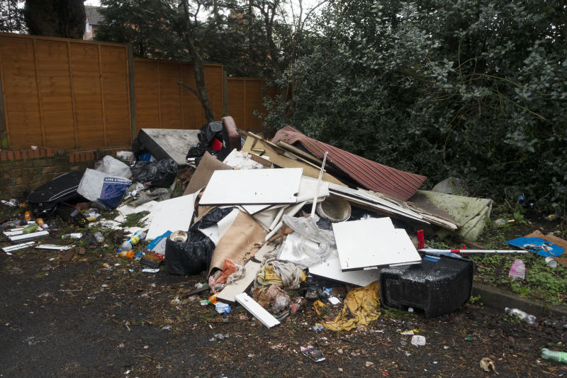 Fly Tipping site in Kings Heath area of Birmingham, United Kingdom. Fly tipping is the illegal dumping of waste instead of using an authorised message such as collection or using a rubbish dump. (photo by Mike Kemp/In PIctures via Getty Images)