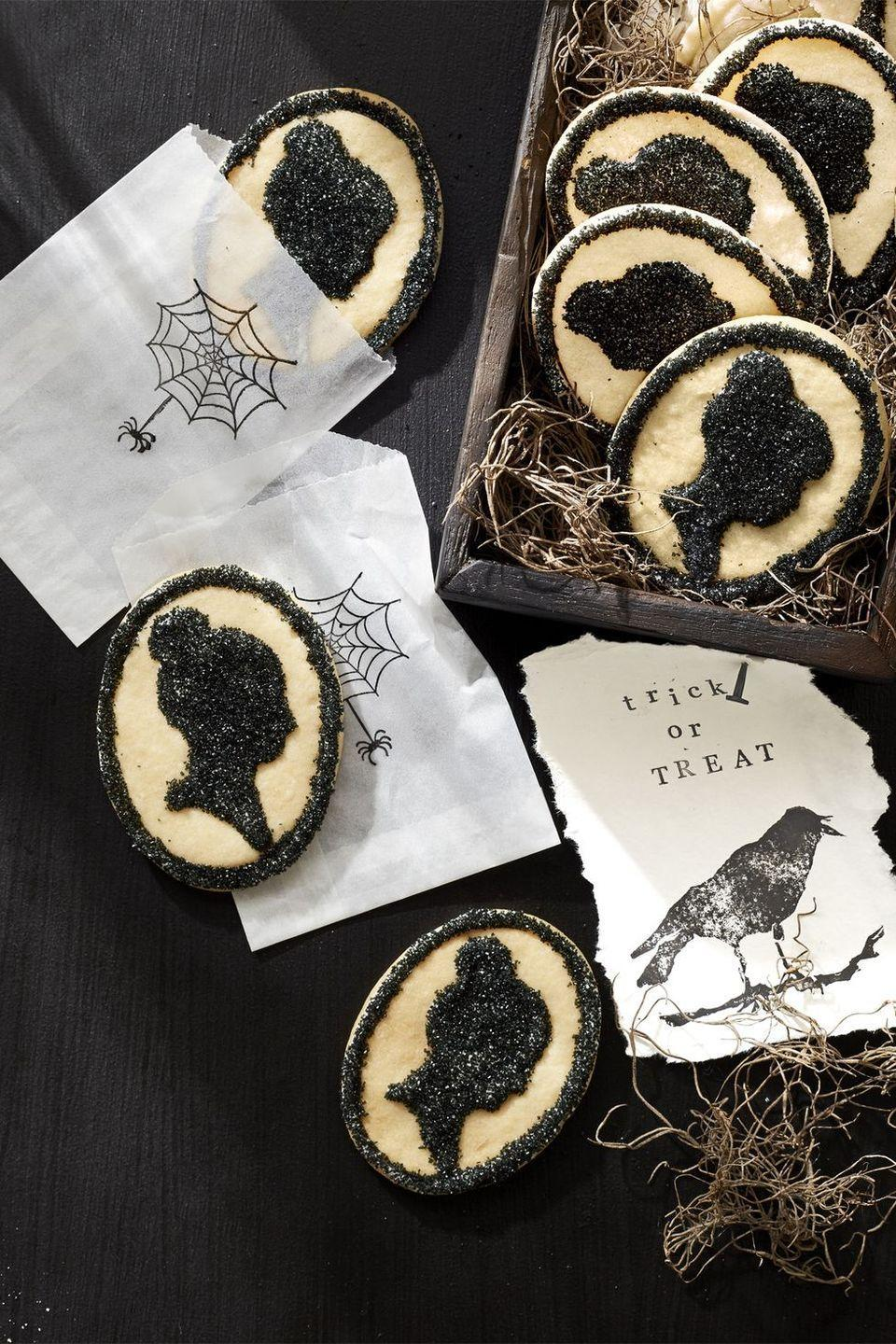 """<p>Jazz up some simple sugar cookies with a classic silhouette-inspired design. </p><p><strong><em>Get the recipe at <a href=""""https://www.countryliving.com/food-drinks/g2651/halloween-cookies/?slide=4"""" rel=""""nofollow noopener"""" target=""""_blank"""" data-ylk=""""slk:Country Living"""" class=""""link rapid-noclick-resp"""">Country Living</a>.</em></strong><br></p>"""