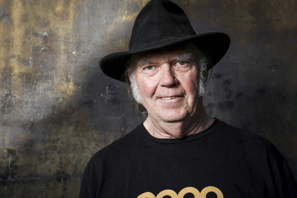 FILE - In this May 18, 2016 file photo, Neil Young poses for a portrait in Calabasas, Calif. Young is among several musicians who are objecting to their songs being used at President Donald Trump's campaign rallies. (Photo by Rich Fury/Invision/AP, File)