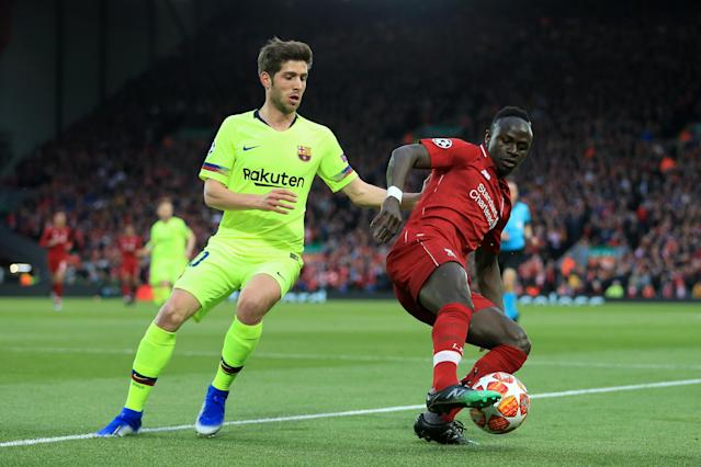 Sadio Mane of Liverpool battles with Sergi Roberto of Barcelona during the UEFA Champions League Semi Final second leg match between Liverpool and FC Barcelona at Anfield on May 7, 2019 in Liverpool, England. (Photo by Simon Stacpoole/Offside/Getty Images)
