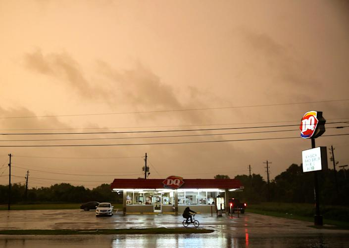A Dairy Queen in Bay City, Texas, stays open as customers try to get in a meal before it closes as Hurricane Nicholas approaches late Monday.
