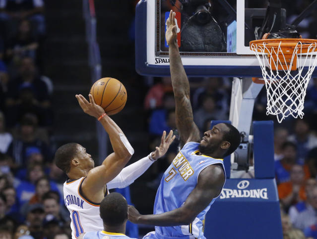 Oklahoma City Thunder guard Russell Westbrook (0) shoots as Denver Nuggets forward J.J. Hickson (7) defends in the second quarter of an NBA basketball game in Oklahoma City, Monday, Nov. 18, 2013. (AP Photo/Sue Ogrocki)