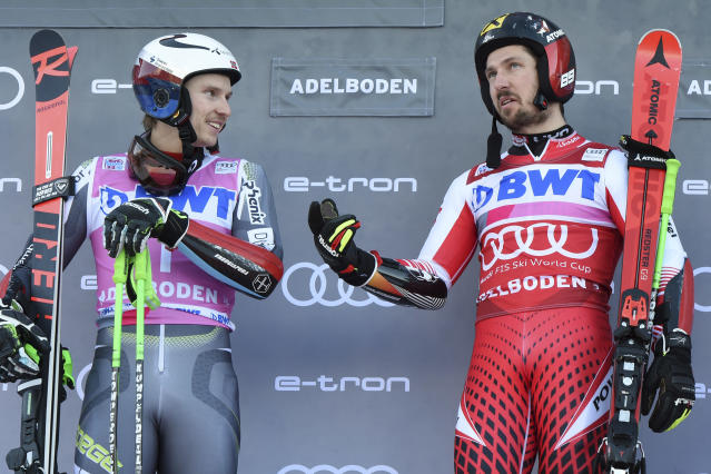 Second placed Norway's Henrik Kristoffersen, left, and first placed Austria's Marcel Hirscher share a word on the podium at the end of a ski World Cup men's Giant Slalom in Adelboden, Switzerland, Saturday, Jan. 12, 2019. (AP Photo/Marco Tacca)