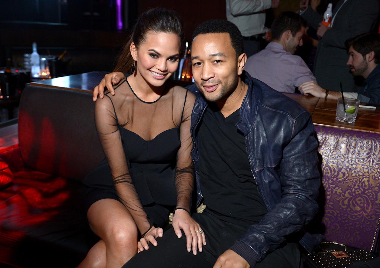 LAS VEGAS, NV - FEBRUARY 13: Sports Illustrated swimsuit model Chrissy Teigen and musician John Legend attend SI Swimsuit on Location at the Marquee Nightclub at The Cosmopolitan of Las Vegas on February 13, 2013 in Las Vegas, Nevada.  (Photo by Michael Loccisano/Getty Images for Sports Illustrated)