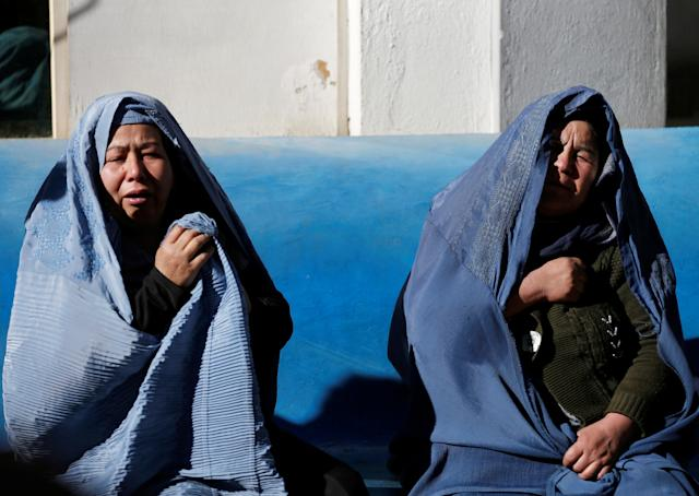 <p>Afghan women mourn inside a hospital compound after a suicide attack in Kabul, Afghanistan, Dec. 28, 2017. (Photo: Mohammad Ismail/Reuters) </p>