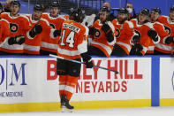 Philadelphia Flyers forward Sean Coutirier (14) celebrates his goal during the first period of an NHL hockey game against the Buffalo Sabres, Saturday, Feb. 27, 2021, in Buffalo, N.Y. (AP Photo/Jeffrey T. Barnes)