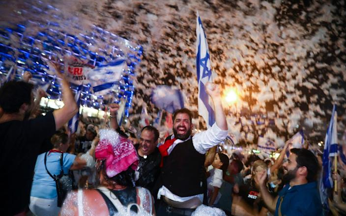 Israelis celebrate the swearing in of the new government in Tel Aviv, Israel - AP/AP