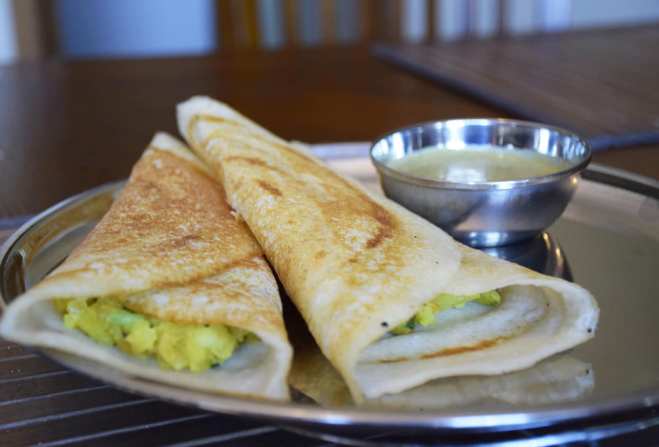 Masala dosa: I finally learned how to make my mom's incredible dosa. The batter must be made at least 12 hours in advance, so I just store some pre-made batter in the fridge. (Courtesy of the author)