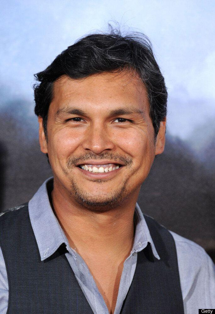 """<strong>Why We Love Him:</strong>Born in Ashern, Manitoba, actor Adam Beach is known for his roles in such blockbuster hits as Smoke Signals, Texas Ranger and Cowboys & Aliens. But he doesn't let fame get to his head; Beach is a devoted dad to his three children (Noah, 16, Luke, 18 and Phoenix, 4) and told Native Peoples magazine that <a href=""""http://www.nativepeoples.com/Native-Peoples/July-August-2011/Struggle-to-the-top-Inspires-Adam-Beach/"""" target=""""_hplink"""">when he's not being a father, he dedicates his free time to helping younger generations of first nations people in need of aid.</a>"""