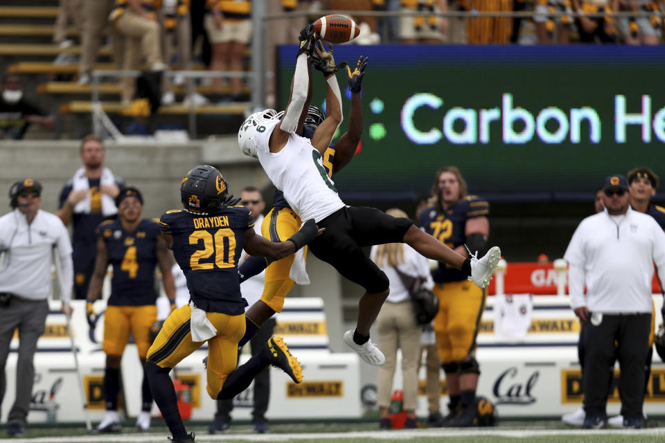 Sacramento State wide receiver Jordan Chin (6) can't catch a pass over California cornerback Lu-Magia Hearns (15) and Josh Drayden (20 during the first half of an NCAA college football game on Saturday, Sept. 18, 2021, in Berkeley, Calif. (AP Photo/Jed Jacobsohn)
