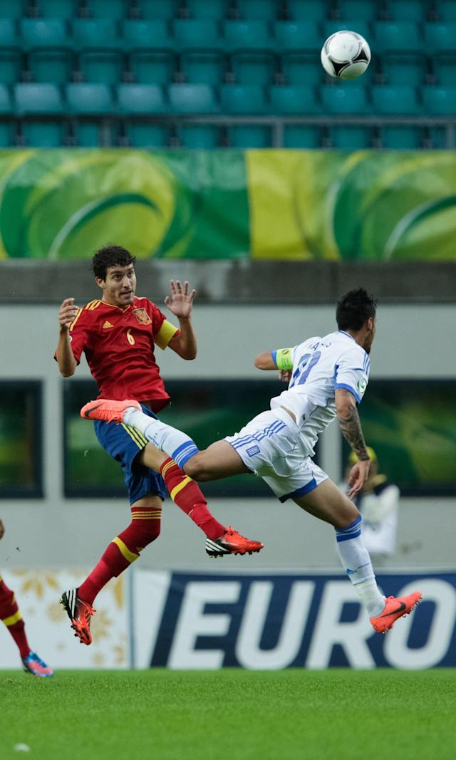 Spanish player Jose Campana (L) vies with Greek players Giorgos Katidis during the UEFA European Under-19 football championships final Spain vs Greece in Tallin on July 15, 2012. AFP PHOTO / JEREK JOEPERAJarek Joepera/AFP/GettyImages
