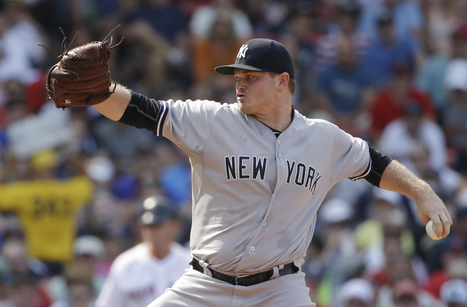 FILE - In this July 12, 2015, file photo, New York Yankees relief pitcher Justin Wilson delivers against the Boston Red Sox in the seventh inning of a baseball game at Fenway Park in Boston. Left-hander Wilson returned to the Yankees after two seasons with the Mets in Queens, agreeing Monday, Feb. 15, 2021, to a one-year contract that includes player and club options for 2022, a person familiar with the agreement told The Associated Press. The person spoke on condition of anonymity because the deal was subject to a successful physical. (AP Photo/Steven Senne, File)