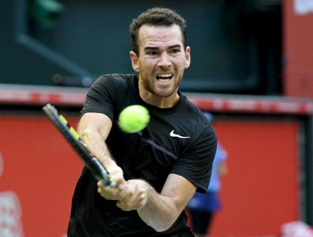 Adrian Mannarino of France returns a shot against Marin Cilic of Croatia during their men's singles semi-final match of the Japan Open in Tokyo on October 7, 2017 (AFP Photo/Toru YAMANAKA )