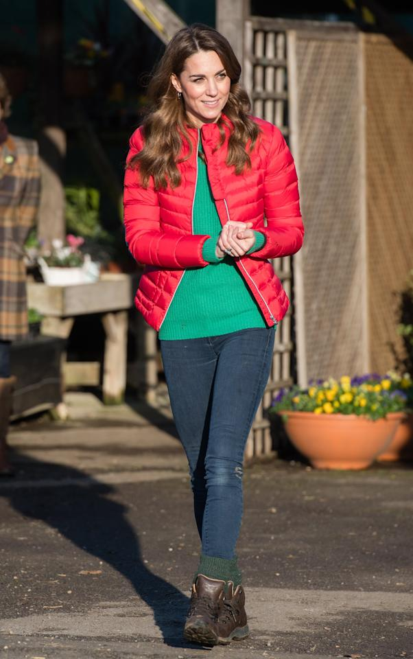 <p>Kate dressed in holiday colors and winter boots, plus a pair of thick hunter green socks that she rolled over her jeans to visit Peterley Manor Farm in December. </p>
