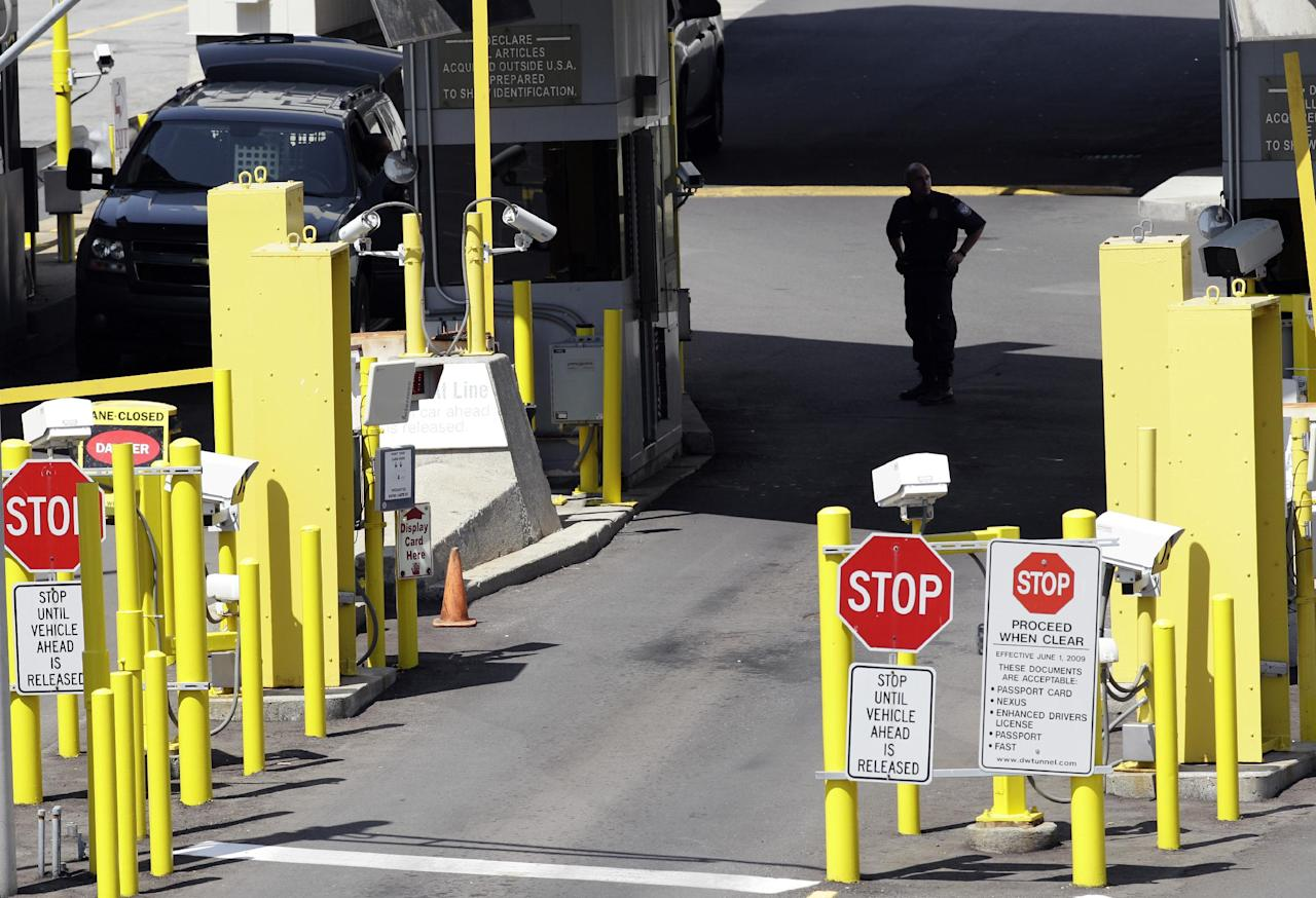 Authorities investigate a bomb threat at the Detroit Windsor Tunnel Thursday, July 12, 2012. The tunnel was closed to traffic after the threat was called in on the Canadian side, tunnel chief executive Neal Belitsky told The Associated Press. The call was made some time after 12:30 p.m. to the duty free shop on a plaza on the tunnel's Windsor side, tunnel executive vice president Carolyn Brown said. The underwater tunnel stretches about a mile beneath the Detroit River, which is one of North America's busiest trade crossings.in Detroit, {  (AP Photo/Paul Sancya)