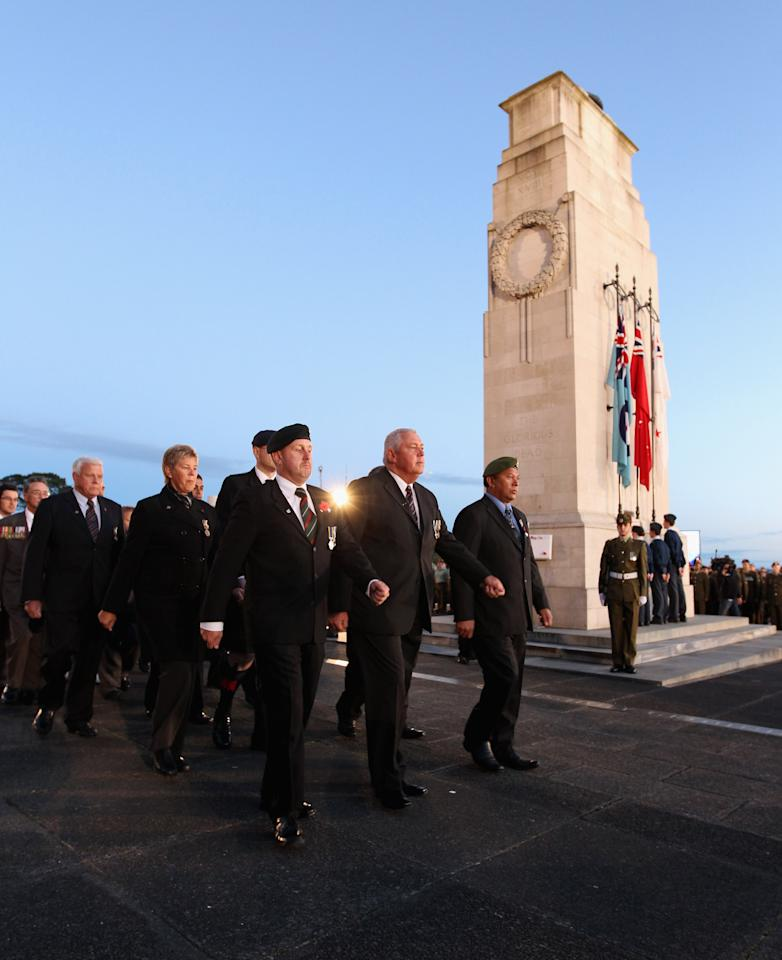 Veterans, dignitaries and members of the public march past the Cenotaph at the Auckland War Memorial Museum during the ANZAC Day Dawn Service on April 25, 2012 in Auckland, New Zealand. Veterans, dignitaries and members of the public today marked ANZAC (Australia New Zealand Army Corps) Day, when First World War troops landed on the Gallipoli Peninsula, Turkey early April 25, 1915, commemorating the event with ceremonies of remembrance for those who fought and died in all wars.  (Photo by Phil Walter/Getty Images)