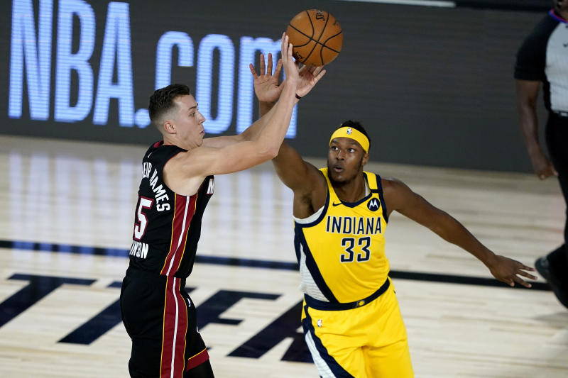 Miami Heat's Duncan Robinson shoots as Indiana Pacers' Myles Turner (33) defends during the first half of an NBA basketball first round playoff game, Monday, Aug. 3, 2020, in Lake Buena Vista, Fla. (AP Photo/Ashley Landis, Pool)