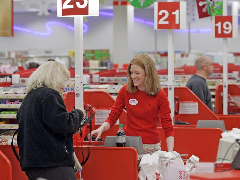 Shopper goes through checkout lane at Target store, Seattle, Washington, photo