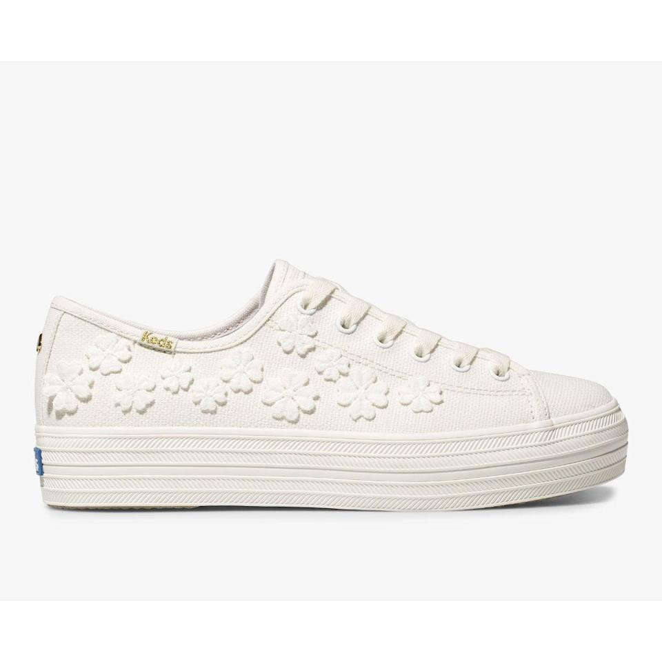 "<p>Wear these <a href=""https://www.popsugar.com/buy/Keds-x-Kate-Spade-New-York-Triple-Kick-Woven-Flower-Sneakers-584510?p_name=Keds%20x%20Kate%20Spade%20New%20York%20Triple%20Kick%20Woven%20Flower%20Sneakers&retailer=keds.com&pid=584510&price=100&evar1=fab%3Aus&evar9=47571677&evar98=https%3A%2F%2Fwww.popsugar.com%2Ffashion%2Fphoto-gallery%2F47571677%2Fimage%2F47571939%2FKeds-x-Kate-Spade-New-York-Triple-Kick-Woven-Flower-Sneakers&list1=shopping%2Cshoes%2Csneakers%2Csummer%2Csummer%20fashion%2Cfashion%20shopping&prop13=mobile&pdata=1"" rel=""nofollow noopener"" class=""link rapid-noclick-resp"" target=""_blank"" data-ylk=""slk:Keds x Kate Spade New York Triple Kick Woven Flower Sneakers"">Keds x Kate Spade New York Triple Kick Woven Flower Sneakers</a> ($100) with a sundress.</p>"
