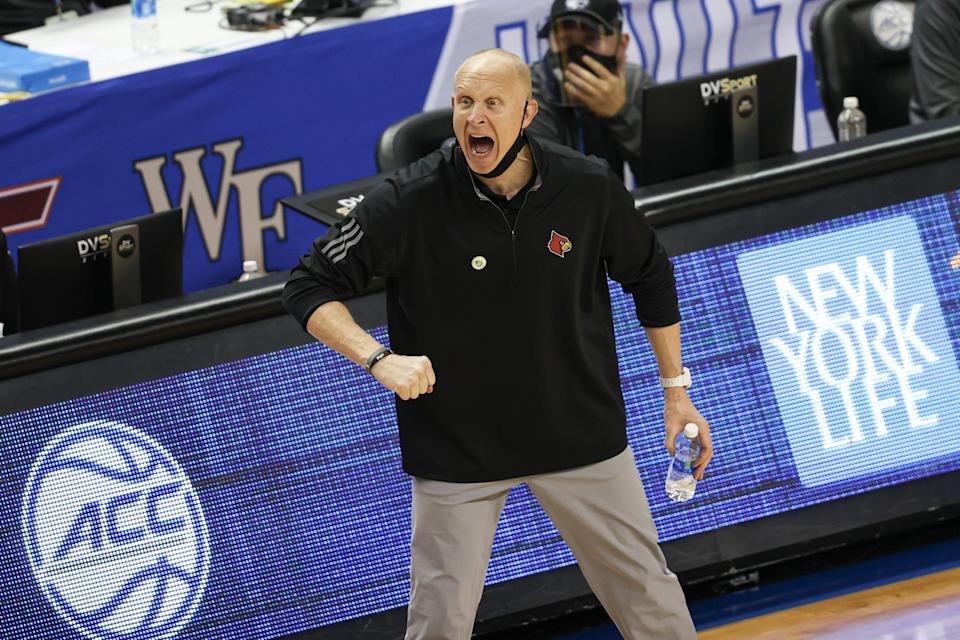 Louisville men's basketball coach Chris Mack has been suspended without pay for six games in November