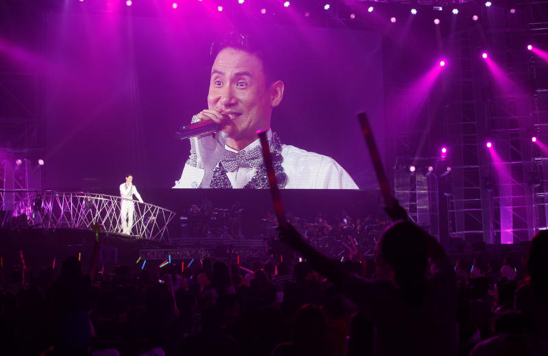 In this May 30, 2012 file photo, Hong Kong singer Jacky Cheung performs during his concert 'Jacky Cheung 1/2 Century Tour' in Hong Kong. The early sales figures for Cheung's long-awaited concert album echo the singer's belief that the music industry needs quality, not speed. One of Cantonese pop's Four Heavenly Kings, Cheung did his 1/2 Century Tour three years ago to coincide with his 50th birthday, but the live concert DVD was not released until this month. His goal was to recreate the live concert experience, so he reasoned that both time and costs were not a priority. (AP Photo/Kin Cheung, File)