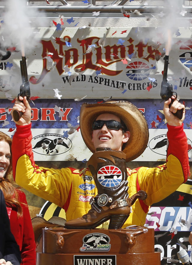 Joey Logano shoots off pistols celebrating winning the NASCAR Sprint Cup Series auto race at Texas Motor Speedway Monday, April 7, 2014, in Fort Worth, Texas. (AP Photo/Mike Stone)