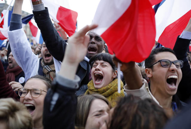 <p>Supporters of French independent centrist presidential candidate, Emmanuel Macron react outside the Louvre museum in Paris, France, Sunday, May 7, 2017. (Laurent Cipriani/AP) </p>