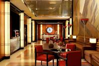 """A top-to-bottom refit of the Lambs Club, the historic thespian hangout in the heart of Midtown's Theater District, by designer Thierry Despont has turned this actors' den into a sleek 76-room hotel with Art Deco lines and ocean liner–inspired fittings that hark back to travel's bygone eras. (The wonderfully accommodating service throughout—is there anything the house butler can't do?—is another throwback we love.) A small but richly furnished lobby gives way to the Lambs Club restaurant, an 80-seater from chef Geoffrey Zakarian where the focal point would be the original stone fireplace if it weren't for the storylines unfolding at the other tables. Rooms are fitted with gorgeous steamer trunk–like wardrobes and desk-vanity combos in chocolate leather, while bathrooms come with wall-to-wall mirrors and rain showers stocked with custom Asprey amenities. Guests can find a break at the cozy Lambs Club Bar, hidden away above the lobby, and at the underground spa, with a clever """"endless"""" lap pool and small gym—probably the only place on the property where you can let them see you sweat."""