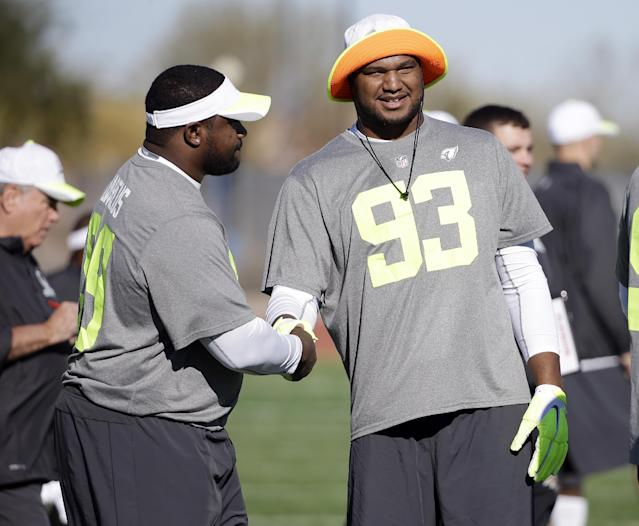 Arizona Cardinals defensive end Calais Campbell (93) greets Buffalo Bills defensive tackle Marcell Dareus, left, during practice for the NFL Football Pro Bowl Saturday, Jan. 24, 2015, in Scottsdale, Ariz. The game is scheduled to be played Sunday in Phoenix. (AP Photo/Mark Humphrey)