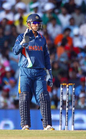 Mahendra Singh Dhoni of India watches on during The ICC Champions Trophy Group A Match between India and Pakistan on September 26, 2009 at The Supersport Stadium in Centurion, South Africa.  (Photo by Julian Herbert/Getty Images) *** Local Caption *** Mahendra Singh Dhoni