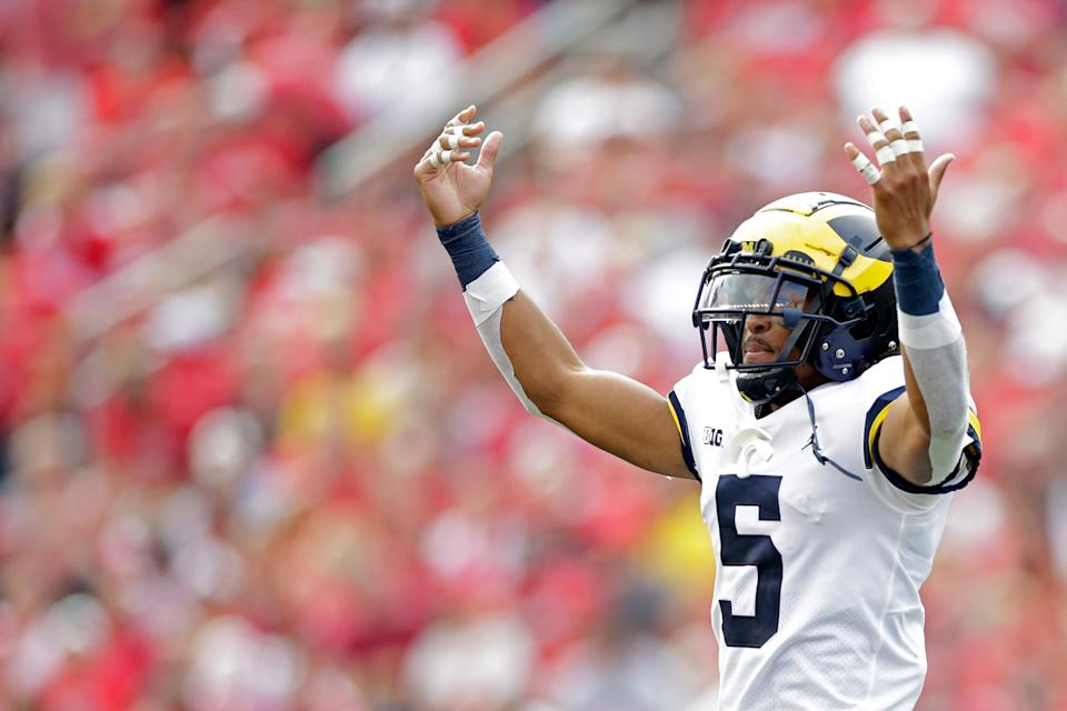 MADISON, WISCONSIN - OCTOBER 02: DJ Turner #5 of the Michigan Wolverines reacts after a turnover against the Wisconsin Badgers at Camp Randall Stadium on October 02, 2021 in Madison, Wisconsin. Michigan defeated Wisconsin 38-17. (Photo by John Fisher/Getty Images)