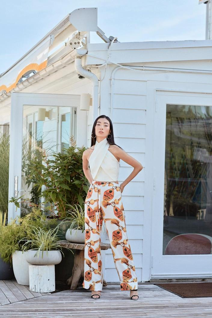 """A model wears the Alice wrap top and Tina satin pant in white from Aliétte's resort collection. <span class=""""copyright"""">(Aliétte)</span>"""