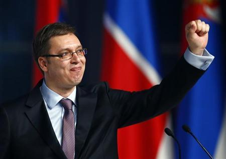 Serbian Deputy Prime Minister and the leader of Serbian Progressive Party Vucic waves to his supporters during a rally in Belgrade