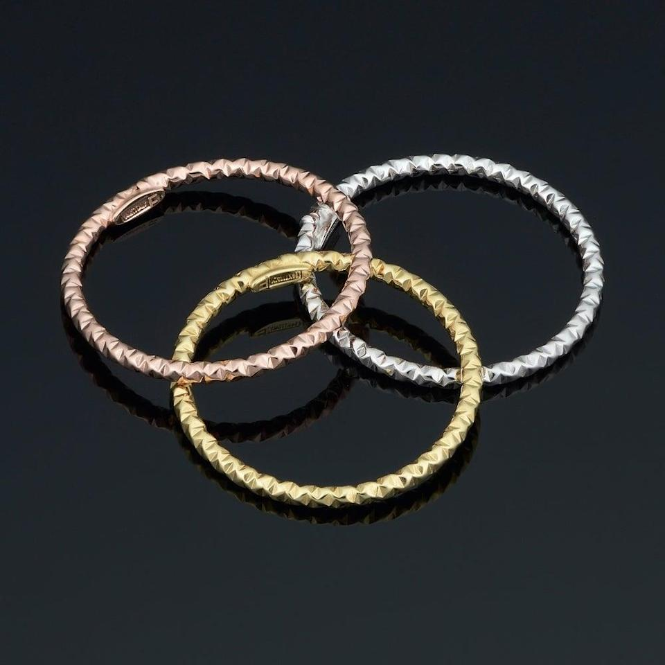 """<h3>Fremada Gold Stacking Ring<br></h3> <br>Despite a dainty appearance, this slim solid gold stacking band still makes a statement, thanks to a faceted, textured finish. At less than $70, you could get one for yourself and one for a friend. (If you're feeling extra splashy, stack it with another Overstock.com find — this wide jade band adorned with a solid gold elephant.)<br><br><em>Shop fine jewelry on <strong><a href=""""https://www.overstock.com/Jewelry-Watches/4/store.html"""" rel=""""nofollow noopener"""" target=""""_blank"""" data-ylk=""""slk:Overstock.com"""" class=""""link rapid-noclick-resp"""">Overstock.com</a></strong></em><br><br><strong>Fremada</strong> 14K Gold Faceted Stacking Ring, $, available at <a href=""""https://go.skimresources.com/?id=30283X879131&url=https%3A%2F%2Fwww.overstock.com%2FJewelry-Watches%2F14k-Yellow-White-or-Rose-Gold-1.5-millimeter-Diamond-cut-Band-Minimalst-Ring%2F29746481%2Fproduct.html"""" rel=""""nofollow noopener"""" target=""""_blank"""" data-ylk=""""slk:Overstock.com"""" class=""""link rapid-noclick-resp"""">Overstock.com</a><br><br><strong>Palm Beach Jewelry</strong> 10K Yellow Gold Genuine Green Jade Elephant Ring, $, available at <a href=""""https://go.skimresources.com/?id=30283X879131&url=https%3A%2F%2Fwww.overstock.com%2FJewelry-Watches%2F10K-Yellow-Gold-Genuine-Green-Jade-Elephant-Ring%2F5296852%2Fproduct.html%3F"""" rel=""""nofollow noopener"""" target=""""_blank"""" data-ylk=""""slk:Overstock.com"""" class=""""link rapid-noclick-resp"""">Overstock.com</a><br><br><br>"""